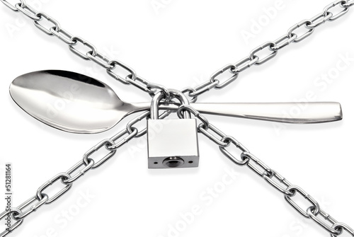 """The spoon encased chain and padlock"""