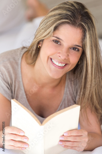 Woman ralaxing with a book