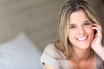 Portrait of a beautiful woman at home smiling