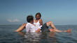 Cheerful attractive couple relaxing in water