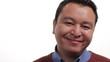 Happy Filipino man's face, close up on white