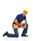 handyman kneeling over white background