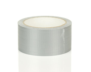 Roll of Grey Adhesive Tape on White with Reflection