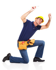 handyman working over white background