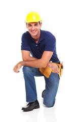 male constructor kneeling