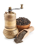 vintage pepper mill and black peppercorn