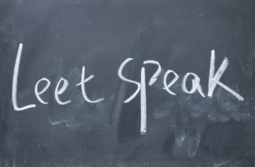 leet speak title written with chalk on blackboard