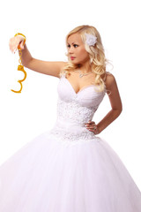 bride in gold handcuffs. beautiful blonde thinking isolated