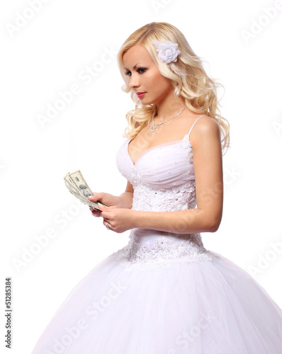 bride with money. counting dollars bills isolated