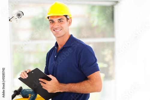 Leinwanddruck Bild happy cctv camera technician