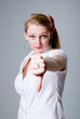 Portrait of beautiful young woman gesturing thumb down