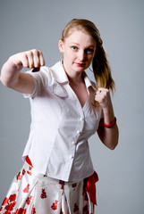 Portrait of an attractive young female punching