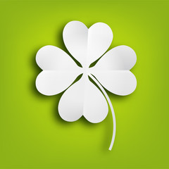 Paper clover leaf on green background.