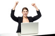 Excited businesswoman raising her arms up