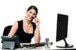 Female executive assisting client over a call