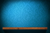 Blank Wood shelf with blue retro wallpaper background