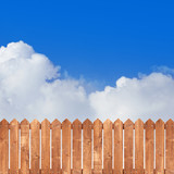 Wood picket fence with blue sky