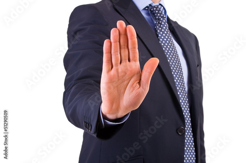 Businessman indicating stop with his hand.