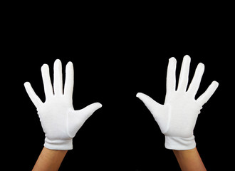 hands are showing ten fingers against black background