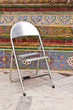 stainless chair with art background