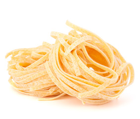Italian pasta tagliatelle nest isolated on white background