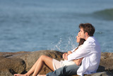 Couple embracing and watching the sea