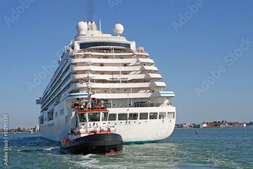 giant cruise ship for the transportation of passengers pulled by