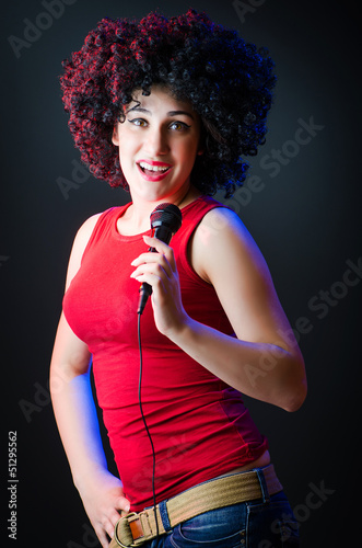 Female performer at disco with mic