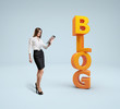 Business lady stand by the word blog.