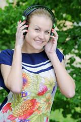 Portrait of young beautiful brunette woman wearing earphones