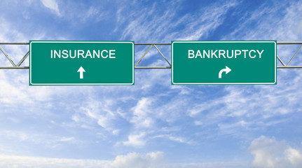 Road sign to insurance and bankruptcy