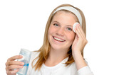 Young cheerful girl removing make-up cleansing pad poster