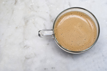 cup of italian coffee isolated on marble