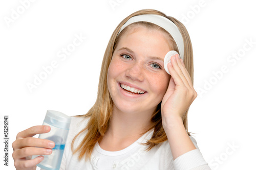 Young cheerful girl removing make-up cleansing pad