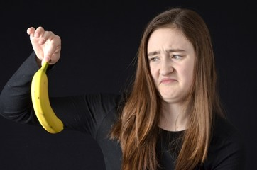 Teen disgusted with banana