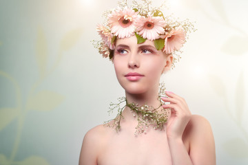 beautiful girl wearing wreath of flowers