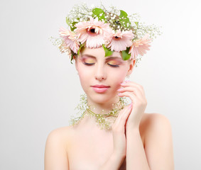 beautiful girl wearing wreath of flowers