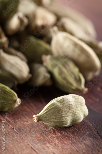 Cardamome seeds on wooden table