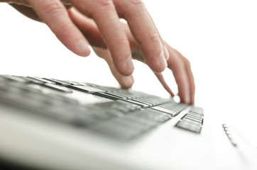 Detail of blurred male hands typing