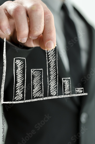 Businessman pulling virtual graph column upwards