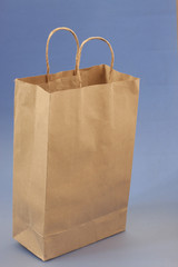 brown paper bag with blue background