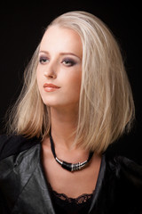 portrait of blond woman with smokey eyes make up
