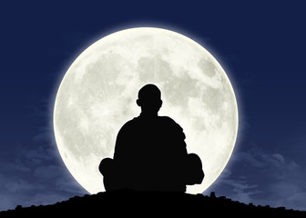 monk in meditation at the full moon