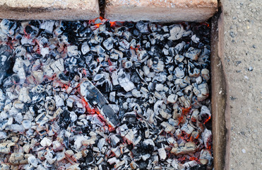 Glowing hot coals in an open fireplace