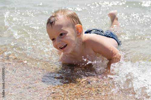 Cute little boy learning to swim