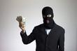 manager ladro con giacca elegante e soldi rubati