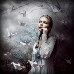 Inspiration. Woman with Flying Origami Swans in Mystic Forest