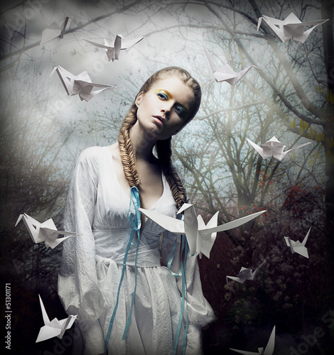 Romantic Blonde with Hovering Origami Birds in Spooky Forest