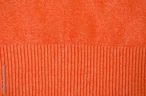 orange woollen sweater pattern detail backdrop