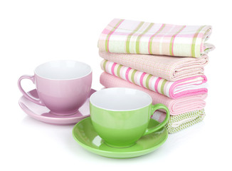 Coffee cups and kitchen towels